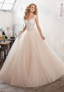 Marigold - A Fairytale Princess Ballgown is Brought to Life with Crystal Beaded Embroidered Appliqués on Tulle Over Sparkle Net.