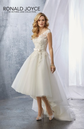 Jacqueline - A TULLE HI LO GOWN WITH A LACE APPLIQUÉD BODICE AND SATIN BOW BELT